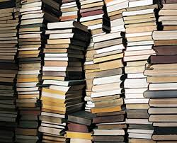 Not unlike the pile of books by my bed that threatens to topple and smother me in my sleep every night....